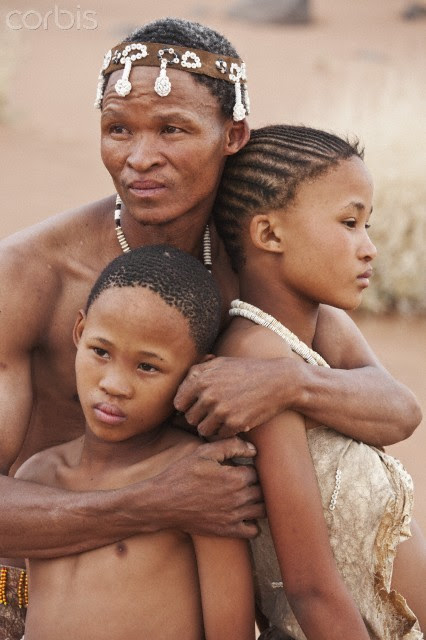 afro-art-chick:   San father hugging his children   Bushman/San People. Farther  embracing his children. Archaeological evidence suggests that they have  lived in Africa for at least 22, 000 years. Namibia. N/a?an ku sê  (www.naankuse.com) an organization owned by Doctor Rudie van Vuuren and  his wife Marlice van Vuuren, one of Namibia's most popular nature  conservationists who is fluent in Khoi San, do a lot of work with the  bushmen.  Amongst others they have the Lifeline Clinic and Bushman  School to tend to the needs of the bushmen. This image, as part of a  series, was taken to raise awareness and funds for the conservation  projects of N/a?an ku sê, as the bushmen had a very close relationship  to animals in the past.   IMAGE: © Martin Harvey/Corbis