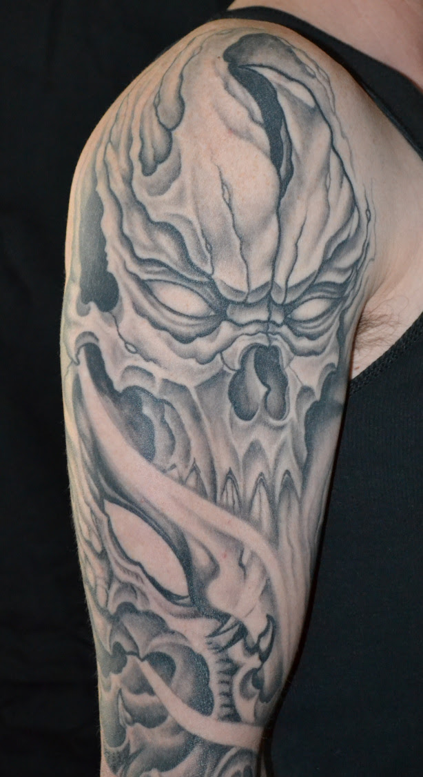 Grey Ink Skull Half Sleeve Tattoo