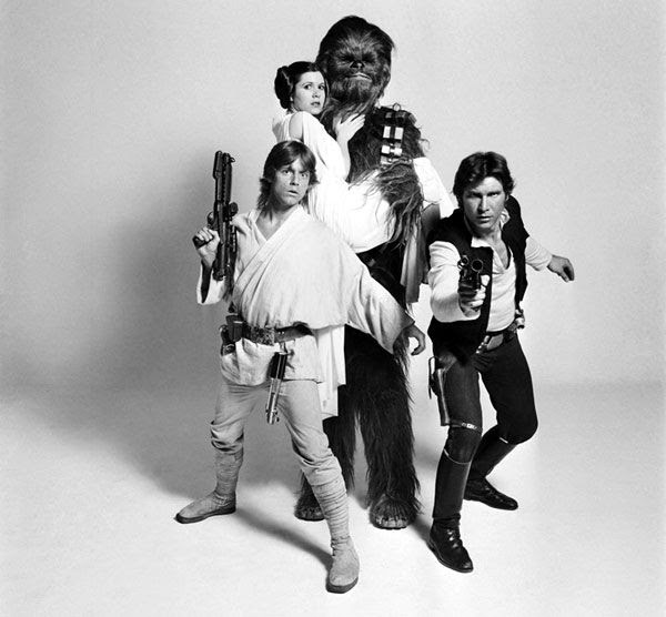 Mark Hamill, Carrie Fisher, Peter Mayhew and Harrison Ford pose in a publicity photo for STAR WARS: EPISODE IV - A NEW HOPE.