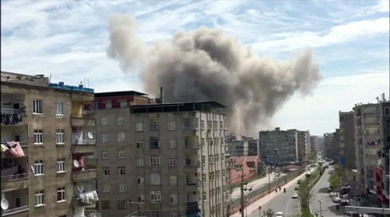 Smoke is seen coming out from a building after an explosion in Diyarbakir, Turkey April 11 ,2017 in this still frame taken from video. REUTERS/REUTERS TV