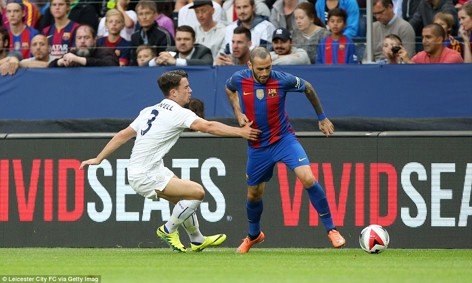Aleix Vidal takes on Ben Chilwell while the Leicester full-back attempts to stop his Barcelona opponent in his tracks