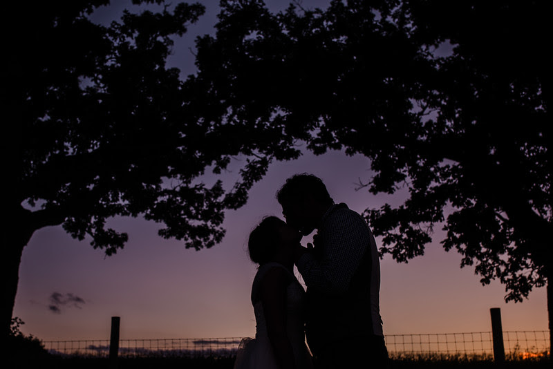 Bride and Groom silhouette photos. A country wedding reception at Busy Barns Adventure farms before a wedding at Busy Barns Adventure Farms in Fort Atkinson Wisconsin about 30 minutes east of Madison and an hour north of Chicago. Photo by Mindy Joy Photography.