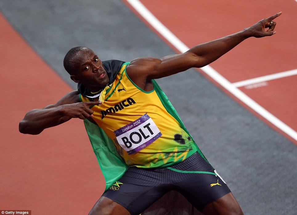 Showman: Usain Bolt celebrates his victory by striking his customary lightning bolt pose in the Olympic Stadium in London