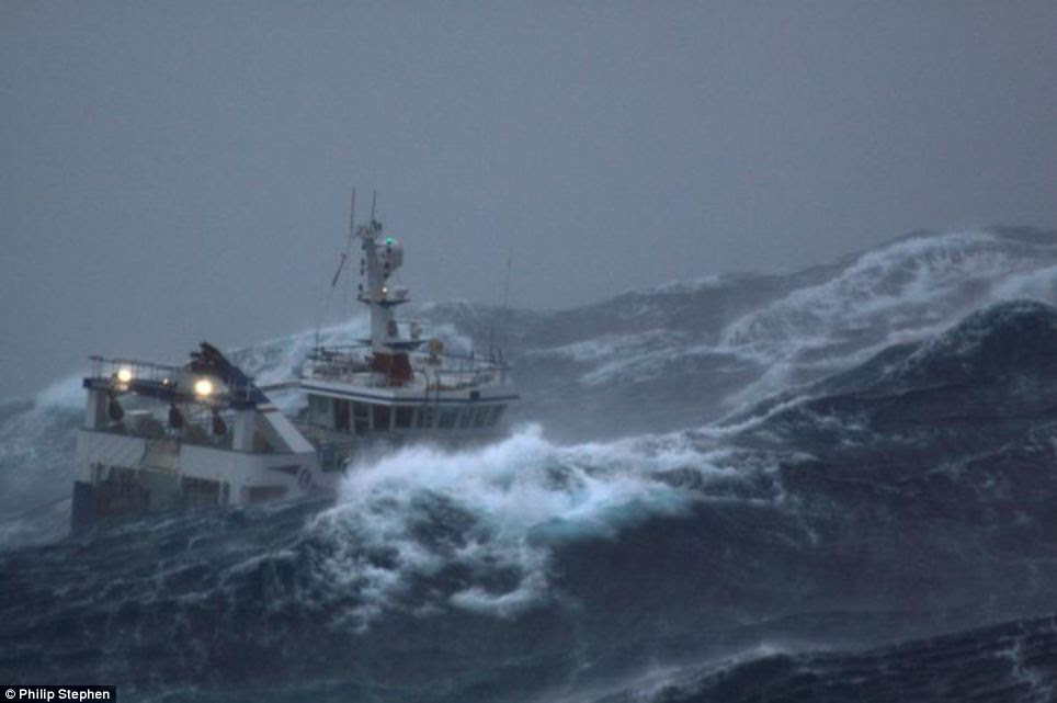 Hang on: The Harvester trawler hurtles straight into the oncoming swell and takes on board a flood of seawater