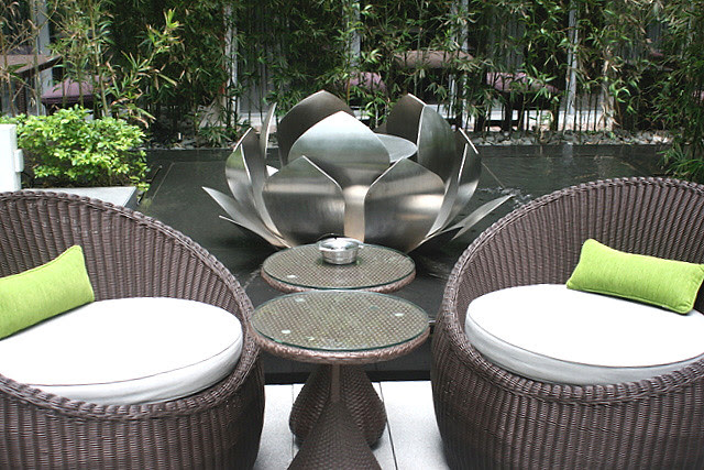 Lotus-shaped open fires and running waterways provide contrasting elements of nature