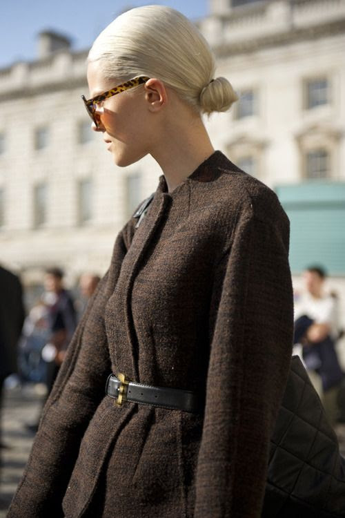 Sleek back hair works wonder with this woollen belted coat for a Madmen-esque look.
