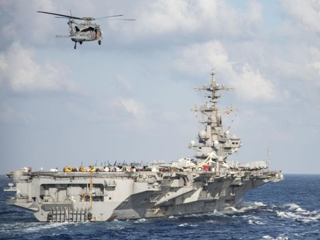 An anti-submarine MH-60S Sea Hawk helicopter from the aircraft carrier USS George H.W. Bush (CVN 77) during a replenishment-at-seain the Mediterranean Sea on June 21. It is likely to have been involved in the hunt for Krasnodar. Picture: US NAVY