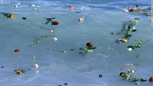 unrar:    Flowers float in the Mediterranean Sea in honor of migrants lost while making the perilous journey to Europe.    Last night more than 80 Syrians and Palestinians refugees have drowned in the Mediterranean close to the Libyan shores trying to reach Europe.
