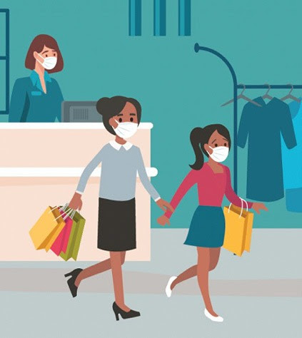 Women wearing masks and shopping indoors