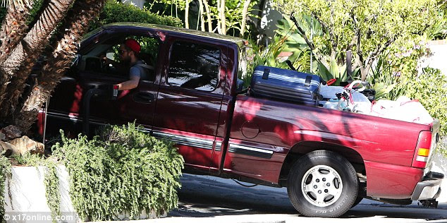 The bachelor pad: Robert drove up to his house ready to unload his truck of his belongings