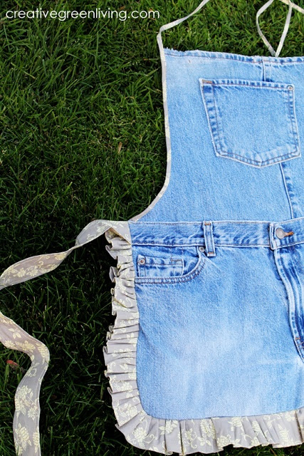 This cute denim apron is actually for sale. She also has a step-by-step tutorial for how to make your own if you have sewing skills