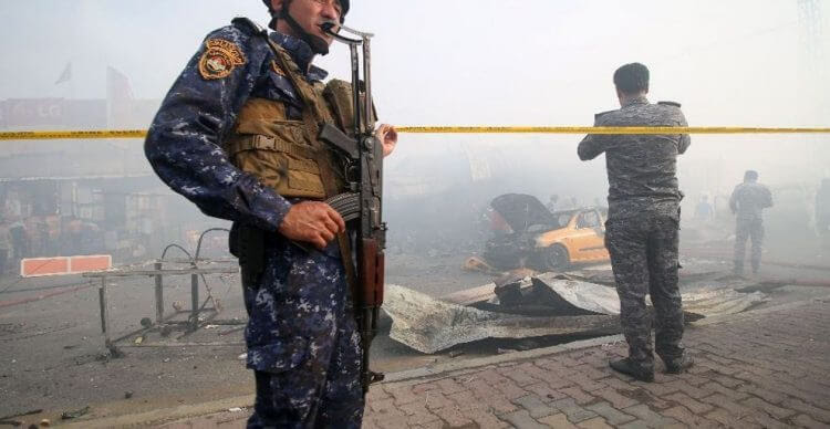 Iraqi soldiers at the site of the ISIS suicide attack in Baghdad today - Photo credit Alalam News