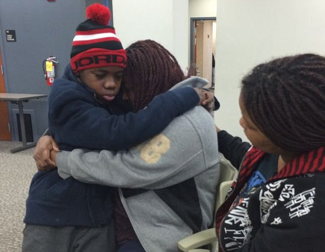 Reunited: This  13-year-old boy is pictured being reunited with his Florida-based mother after he was found imprisoned behind a false wall in the linen closet of his father's Georgia home four years after going missing