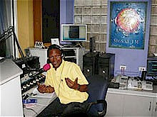 Haitian journalist Jean Gary Apollon, on his daily radio program Sabor Latino, demands that President Barack Obama immediately free the Cuban Five. (Foto del autor) by Pan-African News Wire File Photos
