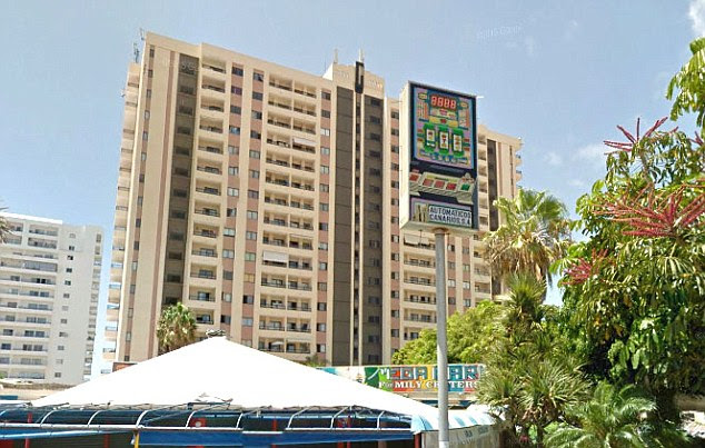 The 25-year-old woman, who is also believed to be British, died instantly after plunging from the 12th floor of the building in the south of the island in the early hours of yesterday morning