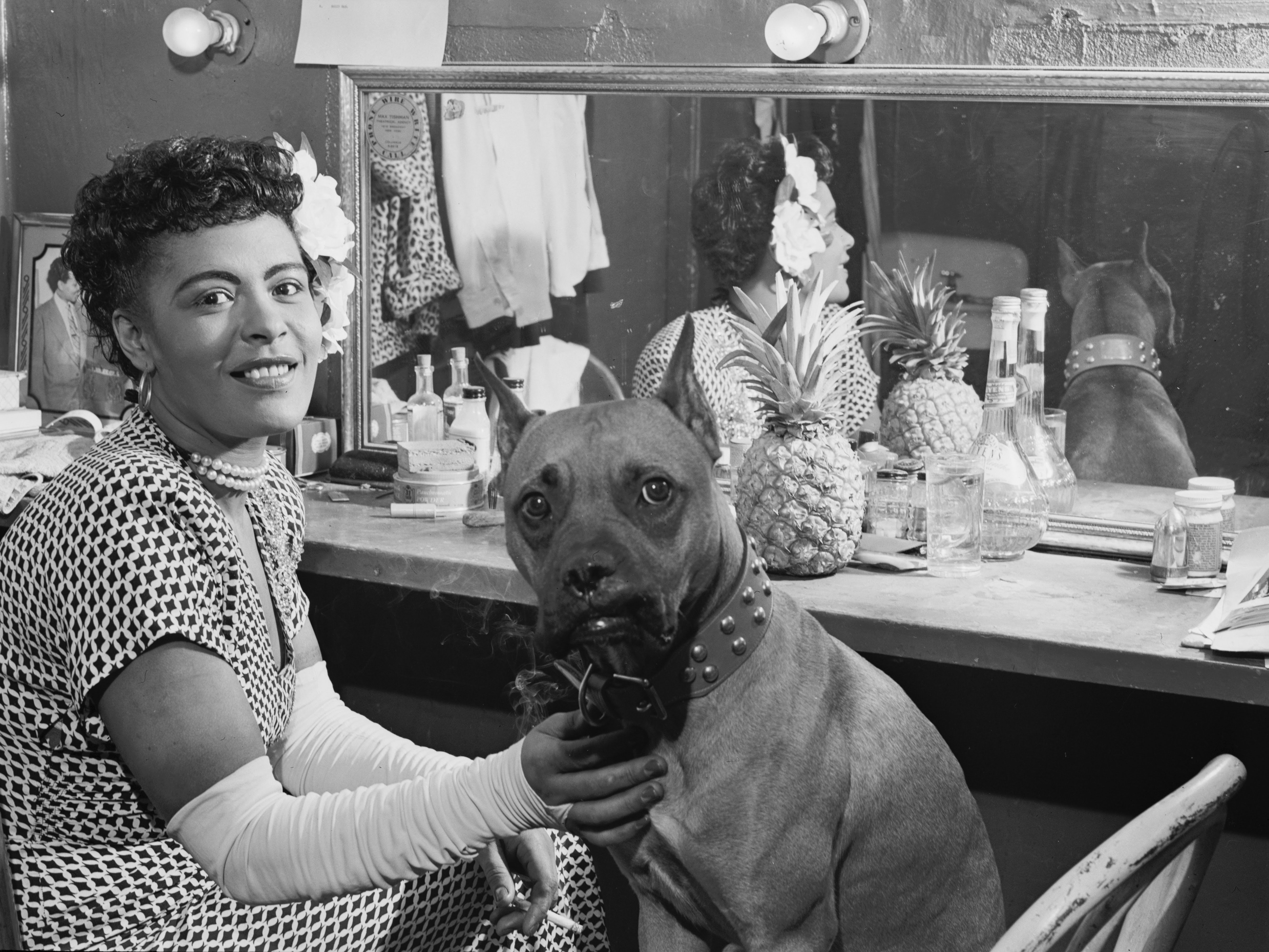 http://upload.wikimedia.org/wikipedia/commons/f/f3/Billie_Holiday_and_Mister%2C_New_York%2C_N.Y.%2C_ca._June_1946_%28William_P._Gottlieb_04271%29.jpg