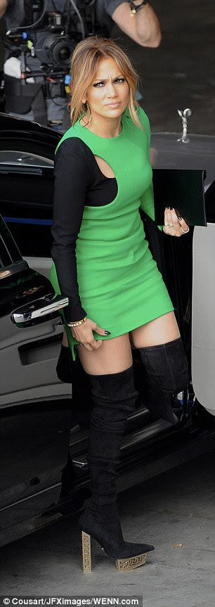 Fashion forward:The dress featured an asymmetrical layout with one black sleeve and the other green, with a small cutout where the colors met on the right shoulder