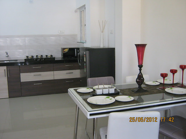 Dining cum kitchen in the show flat - Visit Gagan Akanksha, 1 BHK 1.5 BHK & 2 BHK Flats near  Prayagdham, at Koregaon Mul, Uruli Kanchan, off Pune Solapur Highway, Pune 412202