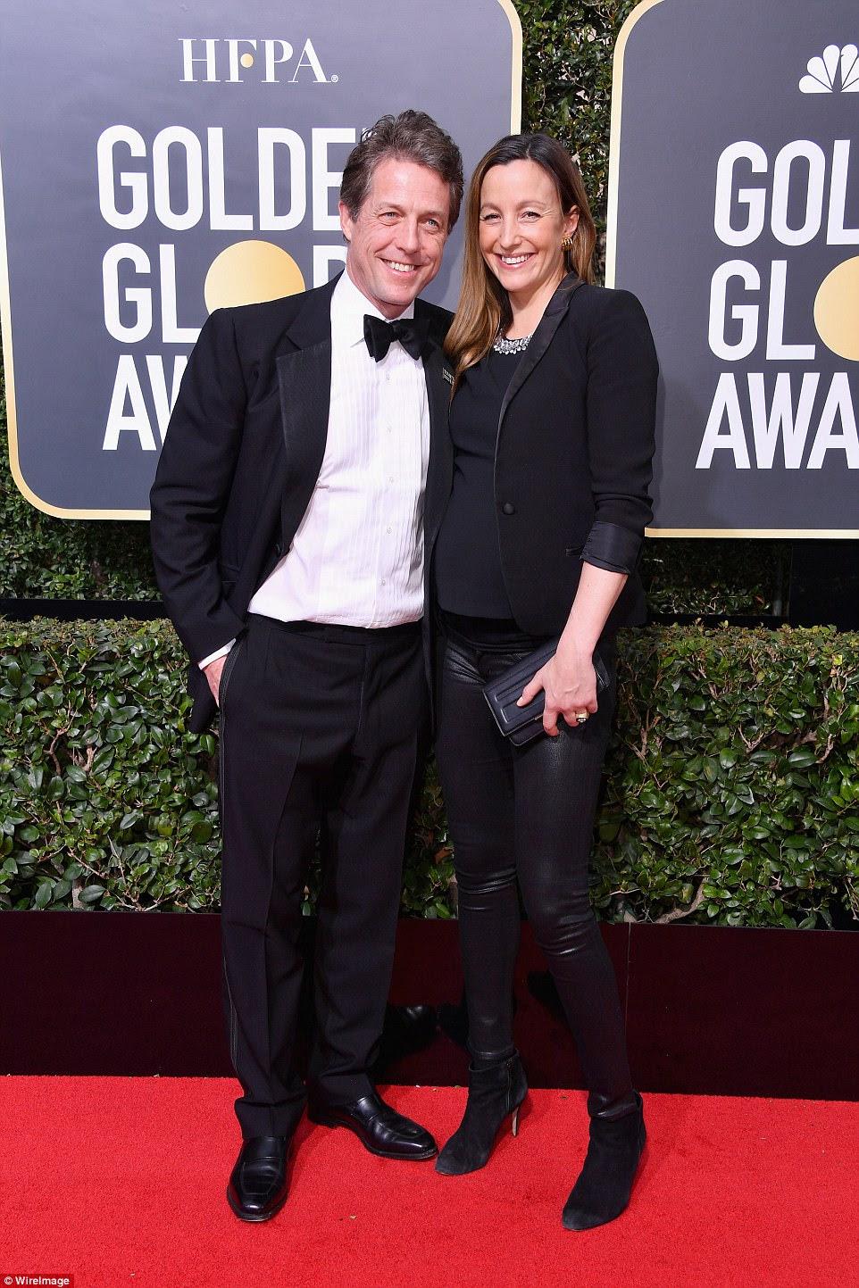 Tão feliz: Hugh Grant e sua namorada Anna Eberstein também participaram