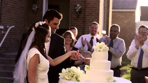 Newlywed couple cutting their wedding cake.   YouTube