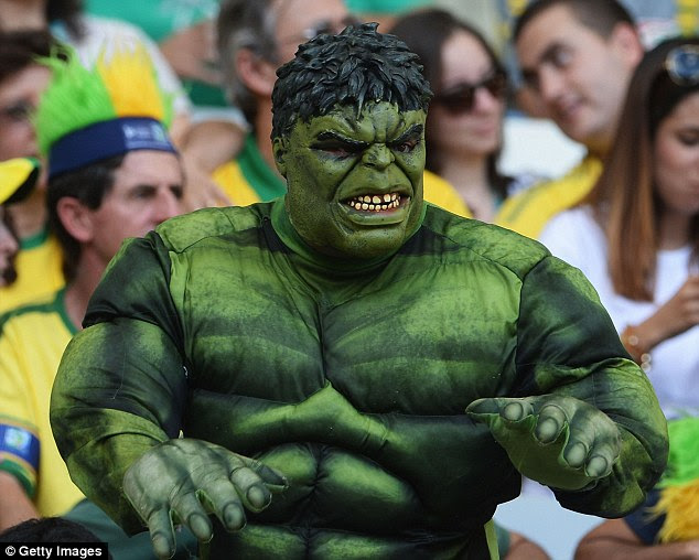 Incredible: This Brazil fanshowed his support for Hulk as his side reached the final