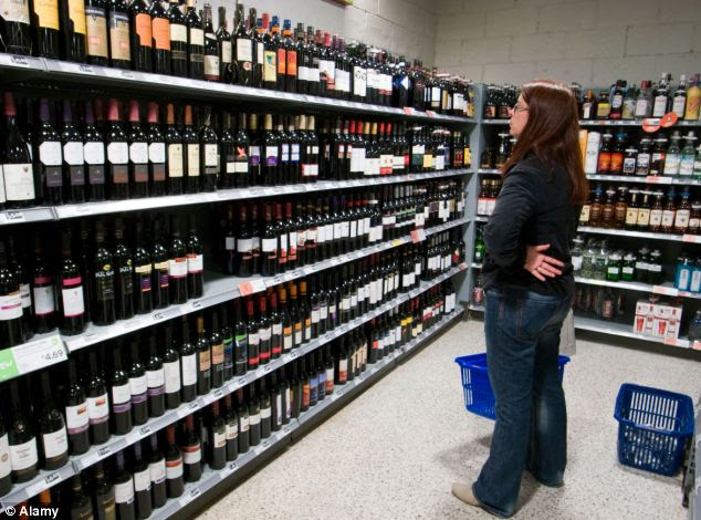 Wait: Instead, shoppers are being asked to wait to pay for goods like alcohol at a different till (file picture)