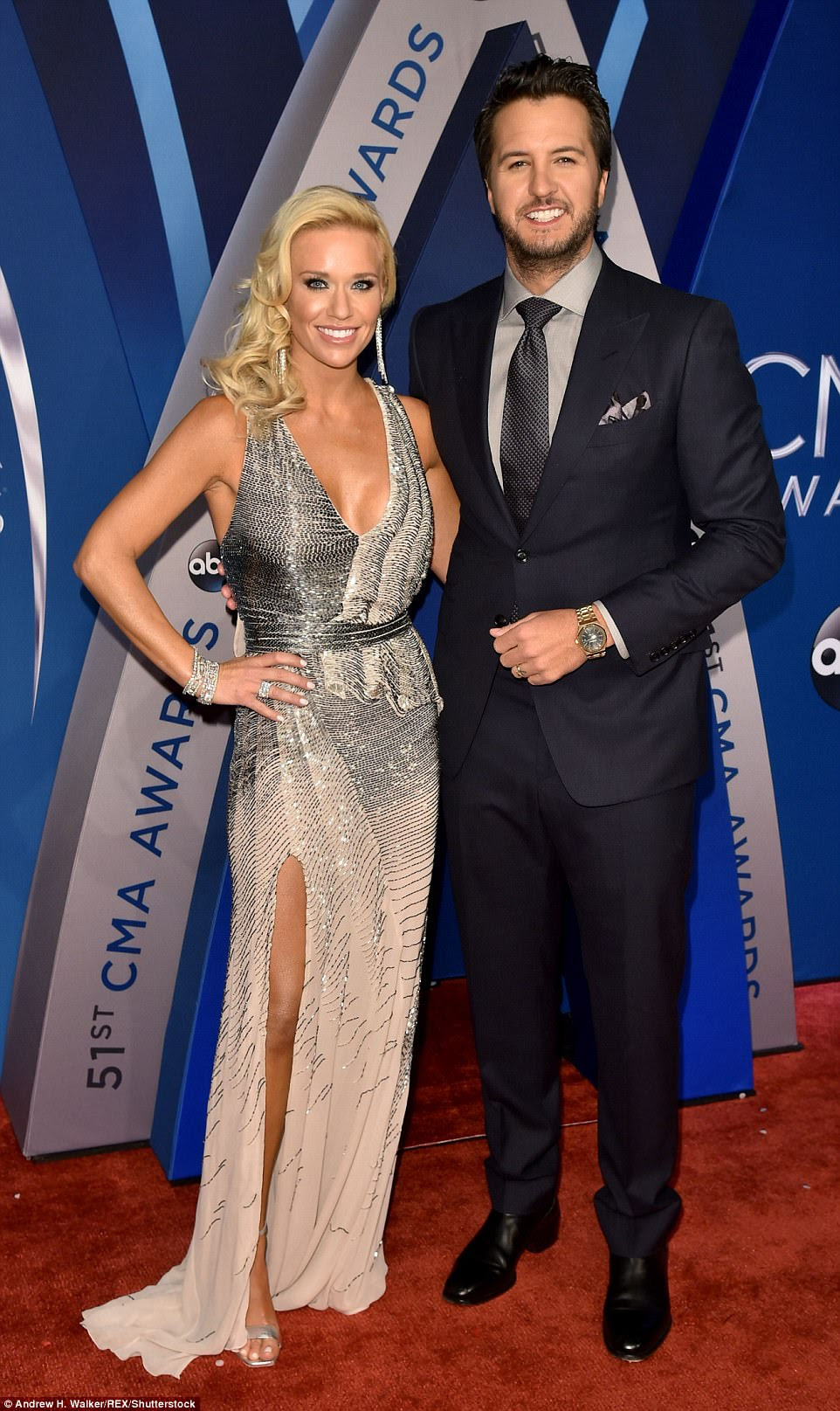 Hitting a fashion high note! Luke Bryan and his wife Caroline Boyer cut a stylish figure on the carpet