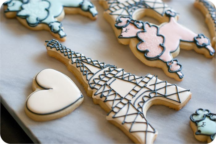 a paris-themed decorated cookie set: eiffel tower, poodles, and hearts in soft colors