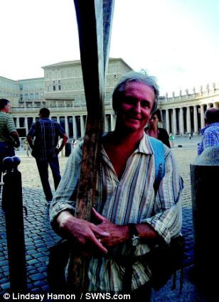 Achievement: Mr Hamon carries his cross in St Peter's Square, Rome - the headquarters of the Catholic Church