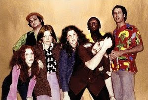 A photo of the original cast of SNL. From left...