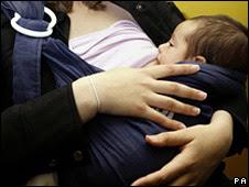 A woman breastfeeding a baby