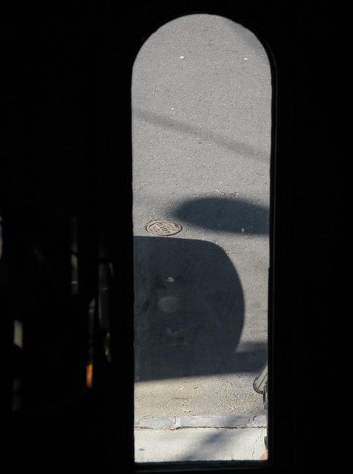 the street seen through a door window