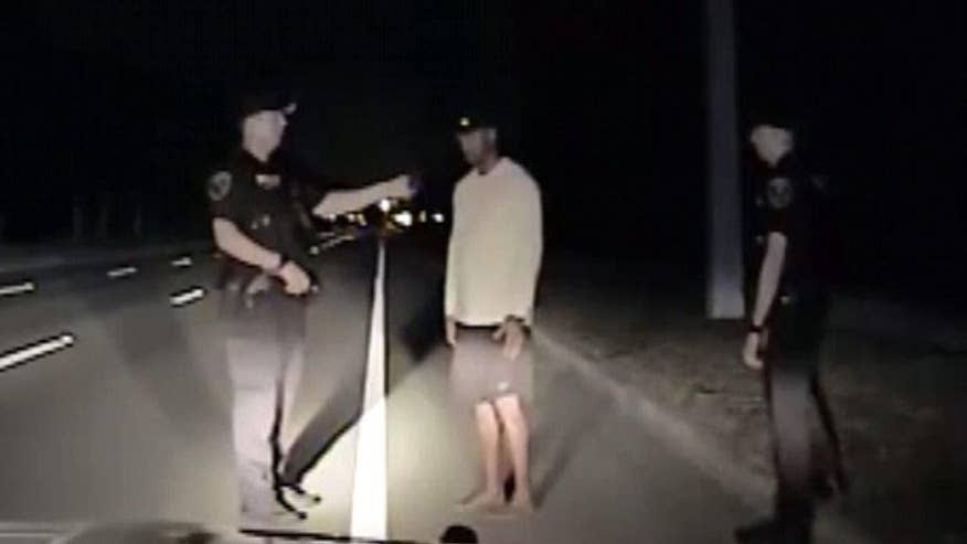 Image result for Florida police release dash cam video from Tiger Woods' DUI arrest