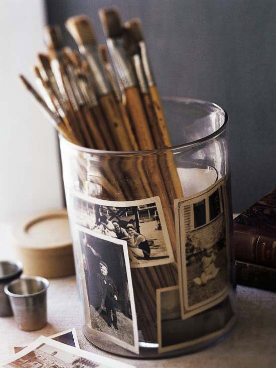 Put photos in a pencil jar with a smaller vase just inside.
