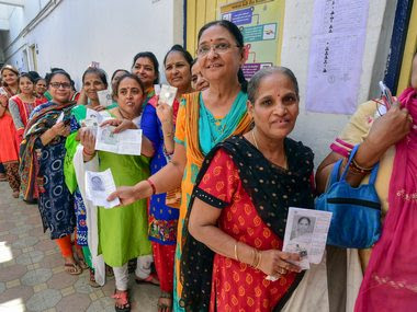 Voters queue up during the third phase of the 2019 Lok Sabha polls in Ahmedabad. PTI