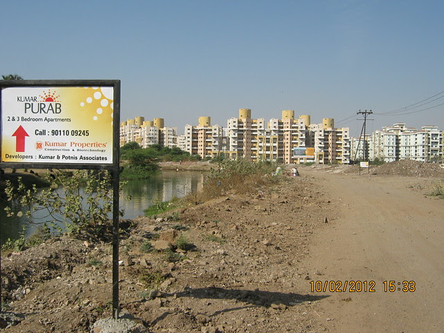 Road by the canal to Kumar Properties' Kumar Purab, 2 BHK & 3 BHK Flats, off Pune Solapur Road, behind Diamond Cars, Hadapsar, Pune 411 028