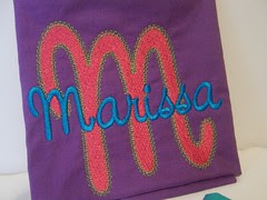 Name embroidered on fabric square for quilt