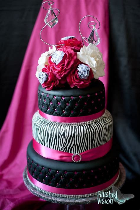 Hot pink and zebra wedding cake i don't like the flowers