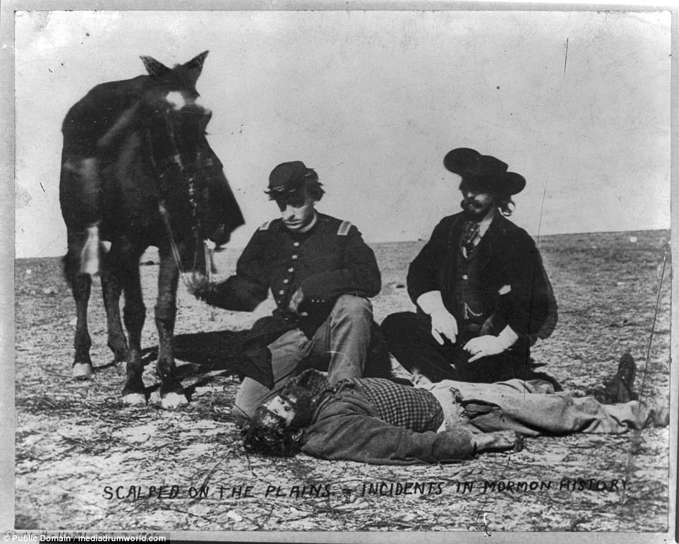 Two men, one wearing military uniform and holding reins of horse, kneeling next to a dead man's scalped body, 1868