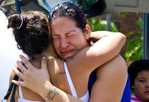 Lupe Diaz, right, sister of Manuel Diaz, gets a hug from Theresa Smith during a protest in front of the Anaheim Police Department, Sunday, July 22, 2012, in Anaheim, Calif. by Pan-African News Wire File Photos