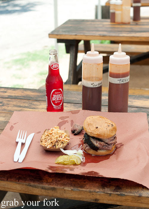 sliced brisket sandwich with slaw at la barbecue austin texas