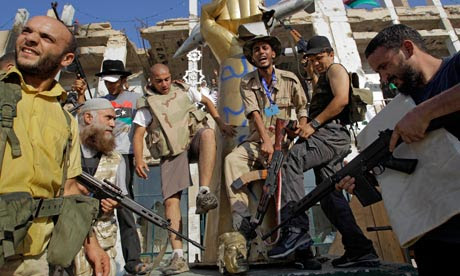 Libya fighters storm Gaddafi compound