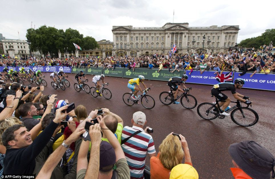 A royal view: The riders speed past Buckingham Palace as they near the finish of the 155km route during the third stage of the Tour de France