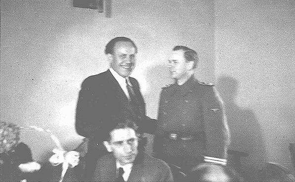 Oskar Schindler (center) at his 34th birthday party with local SS officials. Schindler attempted to use his connections with German officials to obtain information that might protect his Jewish employees. Krakow, Poland, April 28, 1942.