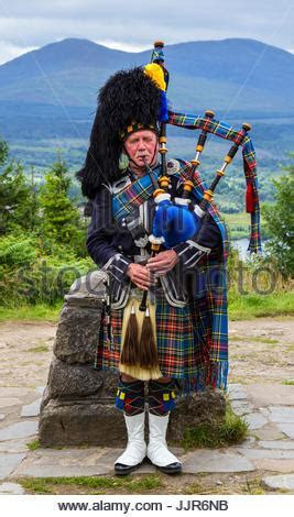 Scots or Scottish Piper playing bagpipes at Glamis Castle