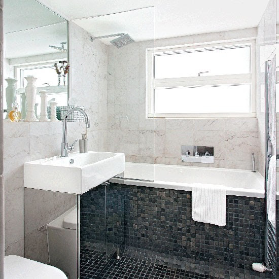 Monochrome bathroom with black mosaic floor tiles ...