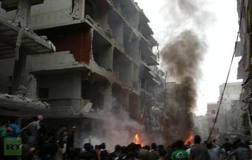 Impact of a car bomb planted by agents of US imperialism operating in Syria. The blast in Damascus killed several people and destroyed buildings in an ongoing war coordinated by the Pentagon and the CIA. by Pan-African News Wire File Photos