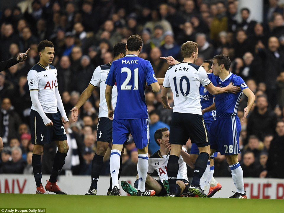 Players exchange words after Cesar Azpilicueta  shoves Jan Vertonghen to the deck after the Belgian tangled with Pedro