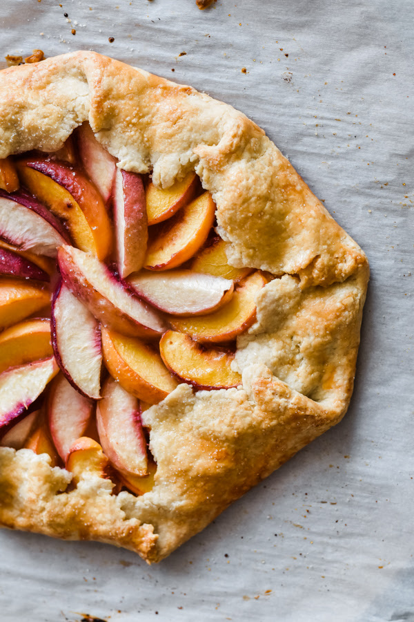juicy peaches together with nectarines wrapped upward inwards a flaky peach nectarine galette