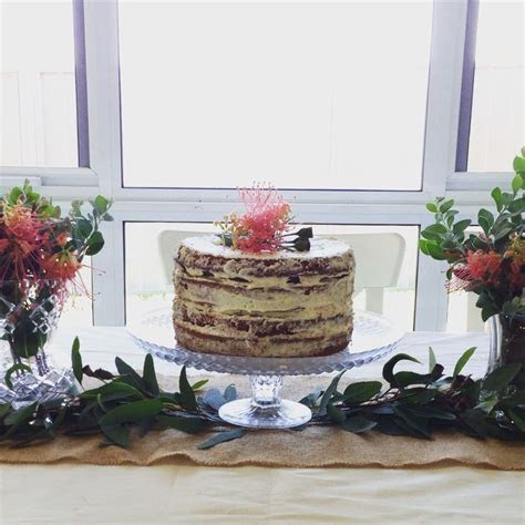 Rustic semi naked cake with native Australian flowers for